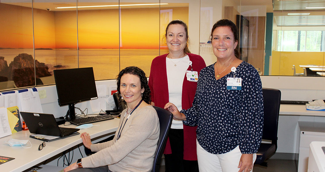 three women at a workstation in the Sanford office