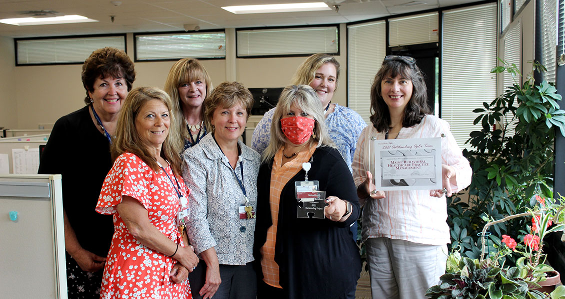 Practice management team with their recent award